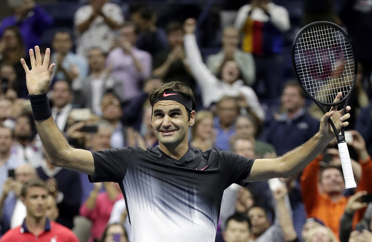 Roger Federer, of Switzerland, celebrates after defeating Frances Tiafoe, of the United States, at the U.S. Open tennis tournament, Tuesday, Aug. 29, 2017, in New York.