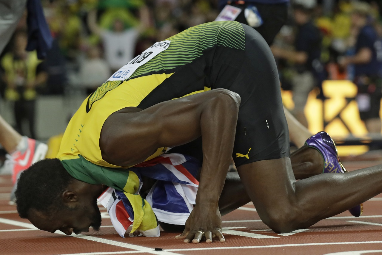 amaica's Usain Bolt kisses the track after placing third in the men's 100m final during the World Athletics Championships in London Saturday, Aug. 5, 2017.