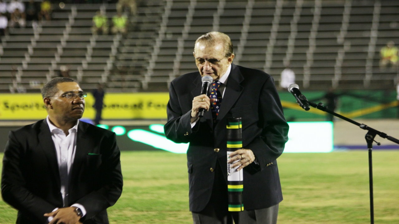 Former Prime Minister Edward Seaga (right) delivers a speech after being honoured at the Jamaica 55 Independence Grand Gala on Sunday at the National Stadium. Prime Minister Andrew Holness looks on. (PHOTOS: Marlon Reid)