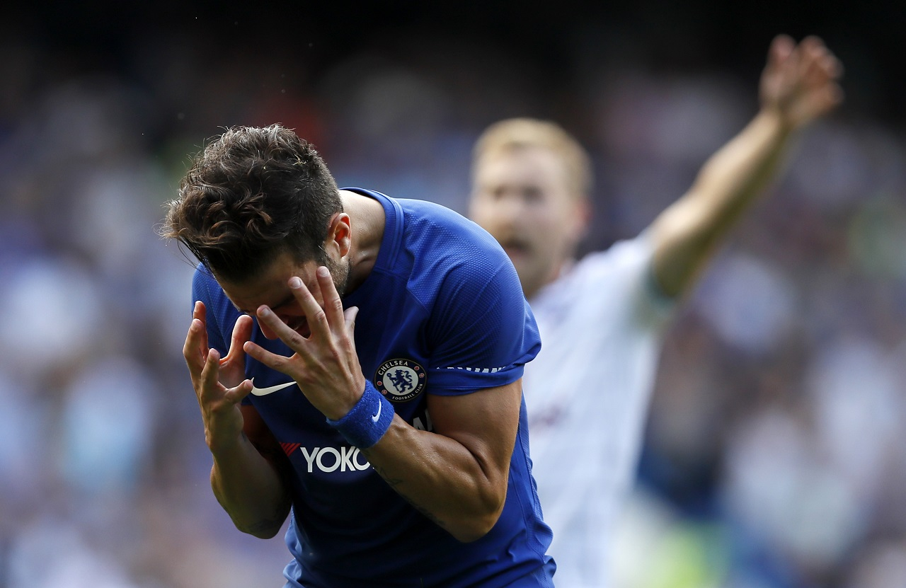 Chelsea's Cesc Fabregas reacts after getting a red card during the English Premier Leaguefootball match against Burnley at Stamford Bridge stadium in London, Saturday, Aug. 12, 2017.