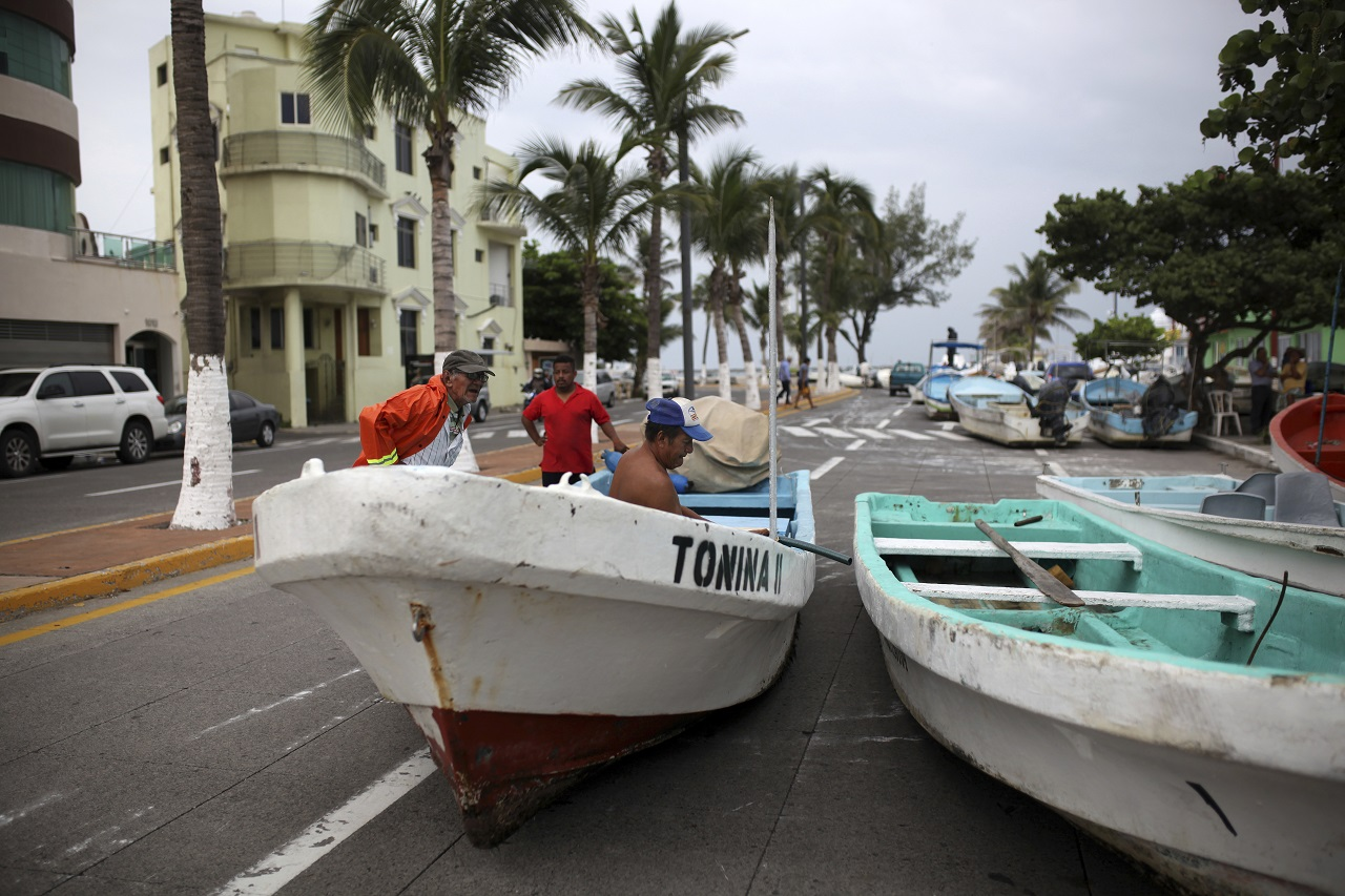 Fishermen move their boats, normally moored in the Gulf of Mexico, onto a coastal road to protect them ahead of the arrival of Tropical Storm Franklin, in the port city of Veracruz, Mexico, Wednesday, Aug. 9, 2017.