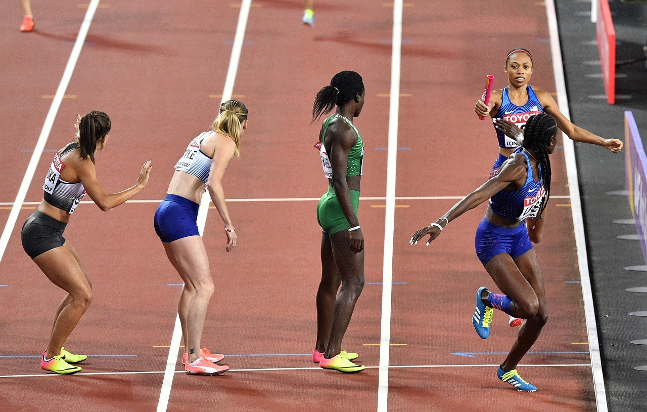 United States' Allyson Felix, top right, hands the baton to teammate Shakima Wimbley during the Women's 4x400 meters relay final at the World Athletics Championships in London Sunday, Aug. 13, 2017.