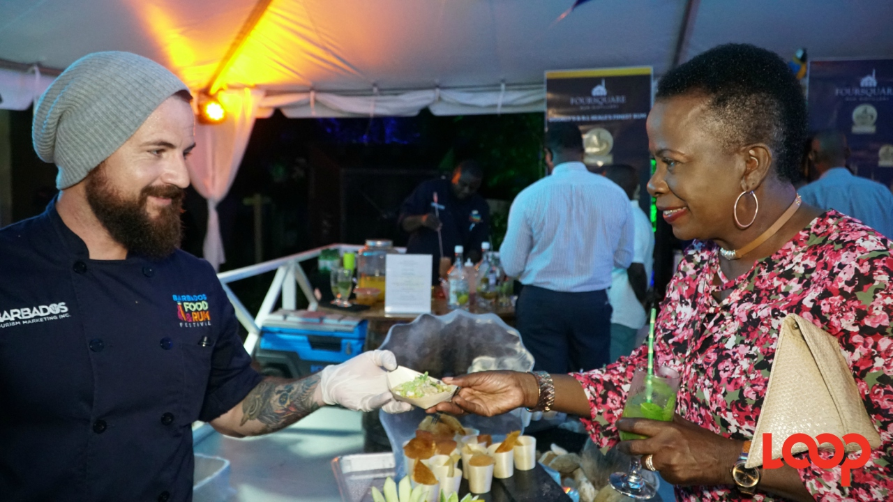 Chef Damian Leach serving one of his seafood dishes at the launch of the 2017 Barbados Food & Rum Festival. (PHOTO: Richard Grimes)
