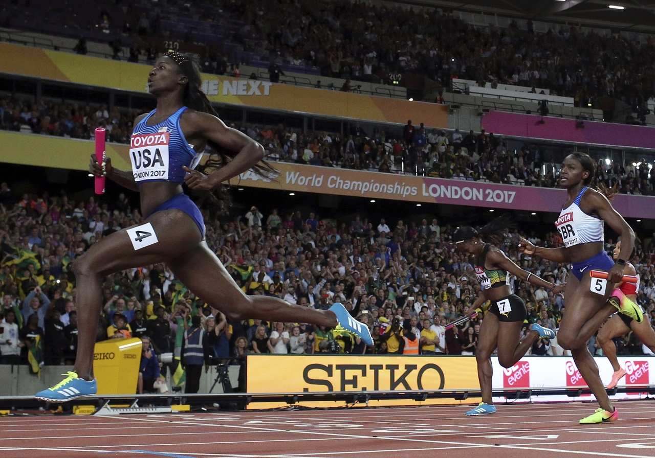 United States' Tori Bowie crosses the line to win the gold in the women's 4x100-meter relay final during the World Athletics Championships in London Saturday, Aug. 12, 2017.