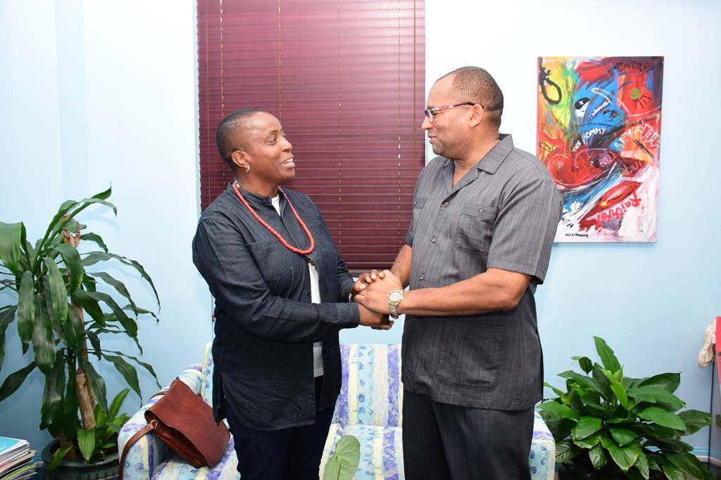 Minister of Tourism, Richard Sealy, greets celebrated Barbadian chef Sarah Kirnon during their meeting at the Ministry of Tourism yesterday. (C.Pitt/BGIS)