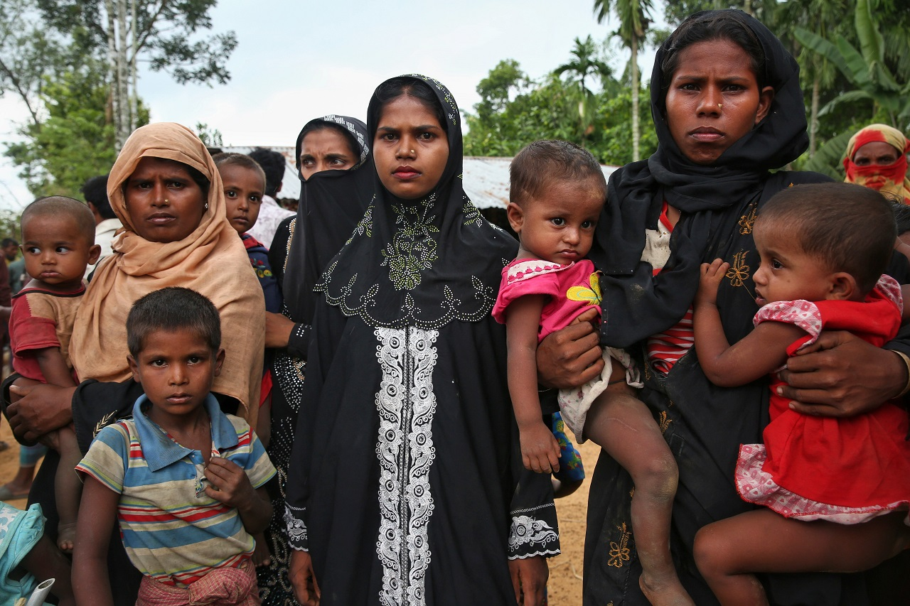 Members of Myanmar's Muslim Rohingya ethnic minority wait to enter the Kutupalong makeshift refugee camp in Cox's Bazar, Bangladesh, Monday, Aug. 28, 2017. Violence in Myanmar's western Rakhine state has driven thousands of ethnic Rohingya Muslims fleeing toward Bangladesh for safety, along with a smaller exodus of ethnic Rakhine Buddhists.