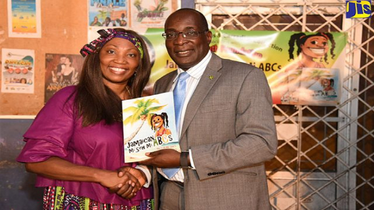 Minister of Education, Youth and Information, Senator Ruel Reid, with author of the book, 'Jamaican Mi Seh Mi ABCs', Valrie Kemp-Davis, at the recent launch, held in the August Town community of St Andrew. (PHOTO: JIS)