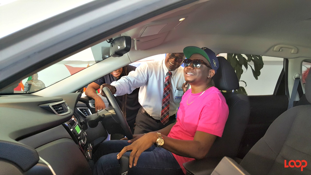 Nissan Sales Manager, Courtesy Garage Ltd., Roger Maxwell showing Ian 'iWeb' Webster some of the features of the 2017 Nissan X-trail that he won.