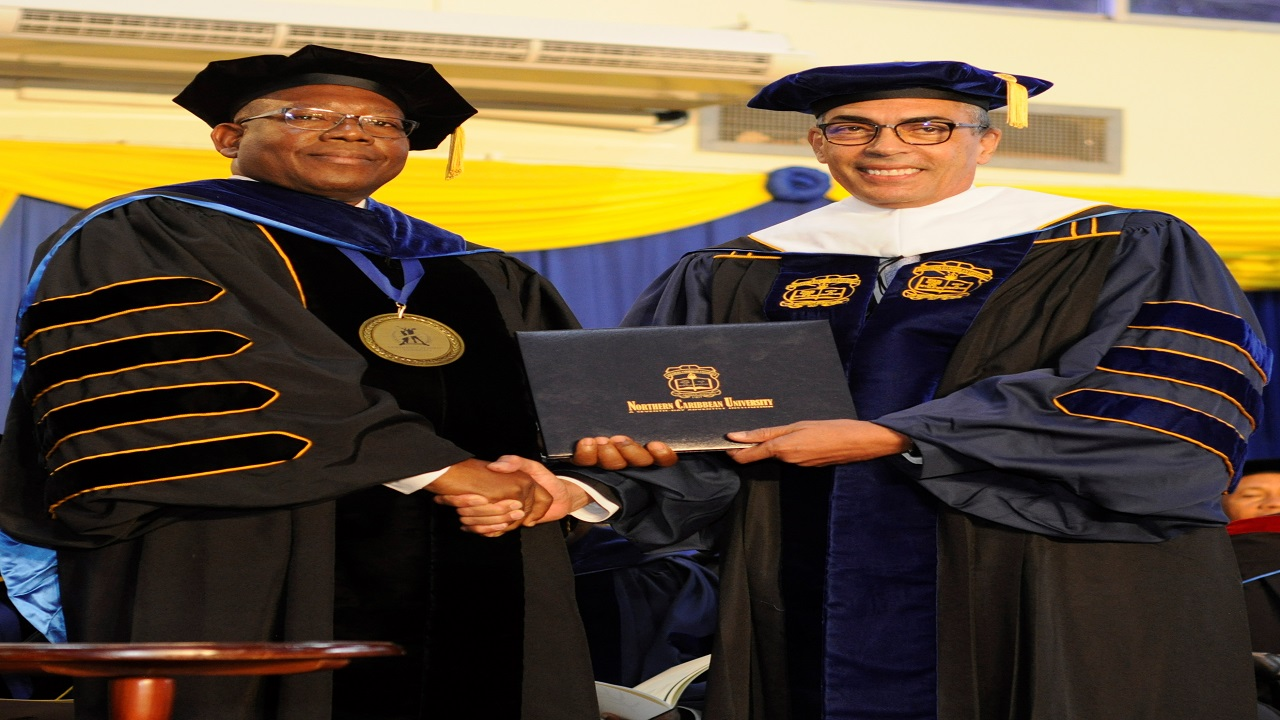 •Richard Byles (left), Chairman of Sagicor Group Jamaica, receives his honorary doctorate from Dr. Lincoln Edwards, President of Northern Caribbean University. The award was presented during the university's graduation ceremony on Sunday in Mandeville.
