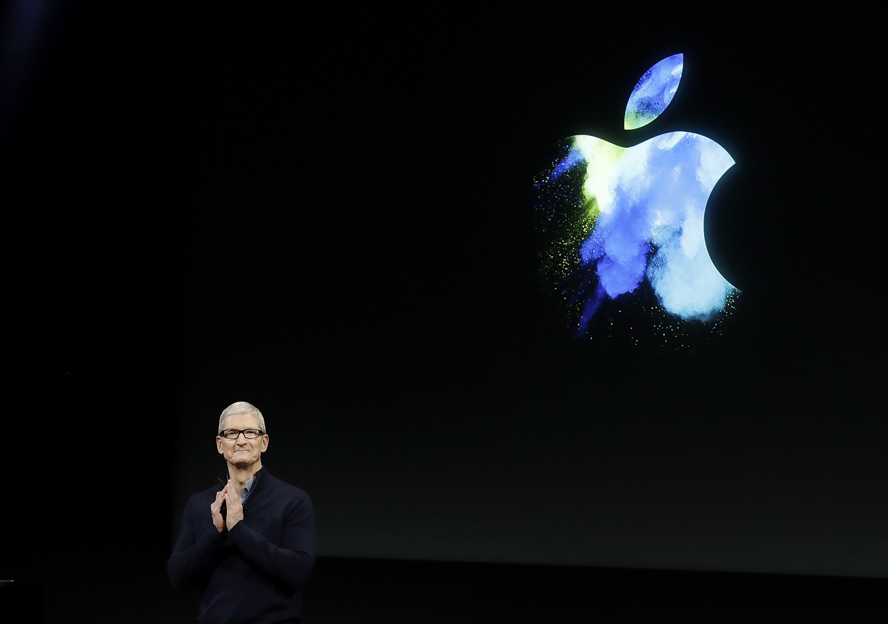 In this Oct. 27, 2016, file photo, Apple CEO Tim Cook speaks during an announcement of new products in Cupertino, Calif. Apple is donating $2 million to two human rights groups as part of Cook's pledge to help lead the fight against the hate that fueled the violence in Charlottesville, Va., during a white-nationalist rally.
