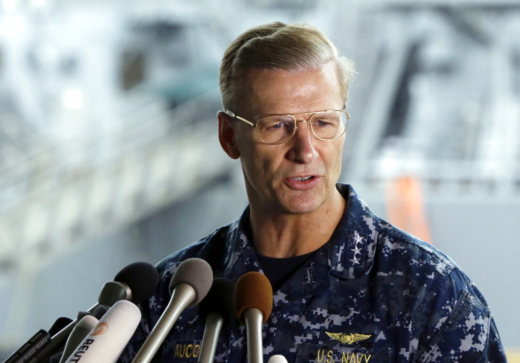In this June 18, 2017, file photo, U.S. Navy Vice Adm. Joseph Aucoin, Commander of the U.S. 7th Fleet, speaks during a press conference, with damaged USS Fitzgerald as background at the U.S. Naval base in Yokosuka, southwest of Tokyo. U.S. officials said that Aucoin is to be relieved of duty after series of ship accidents in the Pacific. (AP Photo/Eugene Hoshiko, File)