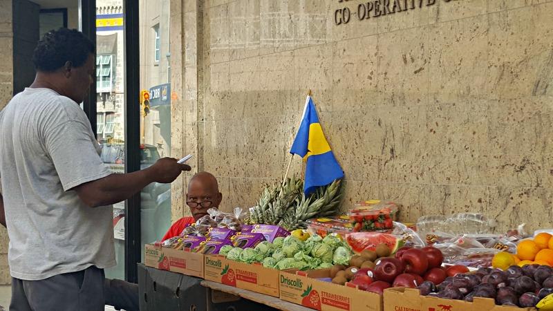 FILE - Vendor in Bridgetown