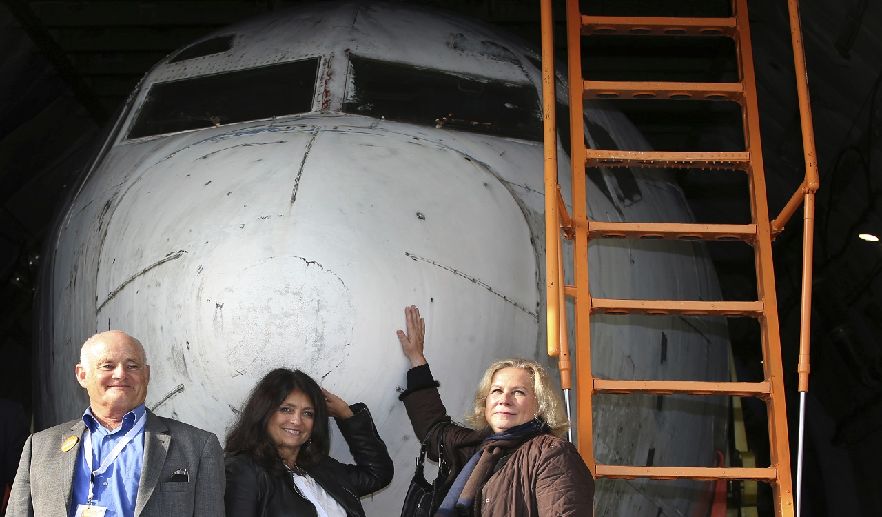 From left: former co-pilot Juergen Vietor, former passenger Diana Muell, and former stewardess Gabriele von Lutzau stand in front of a part of Lufthansa plane 'Landshut' at the airport in Friedrichshafen, Germany, Saturday, Sept. 23, 2017. The Lufthansa passenger jet hijacked to Somalia 40 years ago at the height of the leftist Red Army Faction's campaign against West German authorities has returned home.