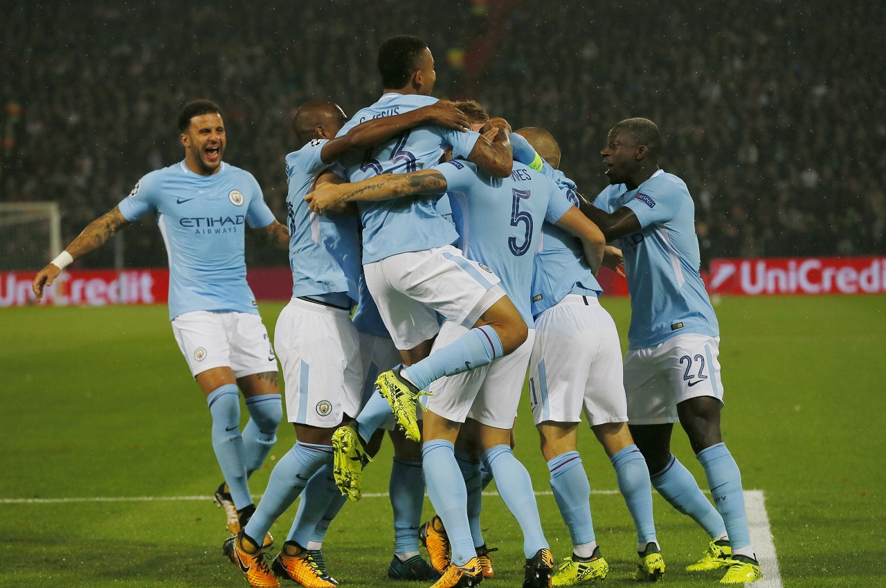 Manchester City's John Stones, third right, celebrates with teammates after scoring the games first goal during their Champions League Group F match against Feyenoord at the Kuip stadium in Rotterdam, Netherlands, Wednesday, Sept. 13, 2017.
