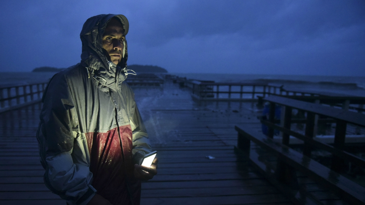 David Cruz Marrero watches the waves at Punta Santiago pier hours before the imminent impact of Hurricane Maria. (AP Photo)