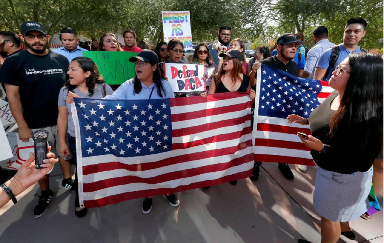 DACA supporters march to the Immigration and Customs Enforcement office to protest shortly after U.S. Attorney General Jeff Sessions' announcement that the Deferred Action for Childhood Arrivals (DACA), will be suspended with a six-month delay, Tuesday, Sept. 5, 2017, in Phoenix.