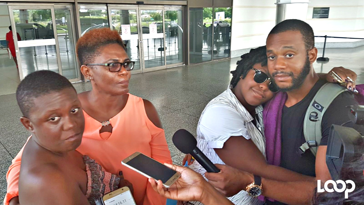 The Weekes family reunited at Grantley Adams International Airport: (L-R) Sabrina Weekes, mother Vicki, sister Renee and brother Shane.
