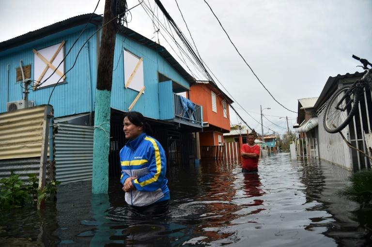 Une rue inondée après le passage de l'ouragan Maria à Juana Matos, le 21 septembre 2017 à Porto Rico HECTOR RETAMAL (AFP)