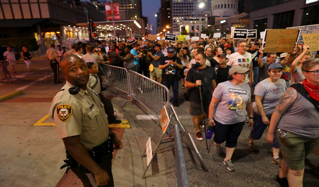 Protesters rally in downtown St. Louis as fans arrive for a Billy Joel concert at Busch Stadium on Thursday, Sept. 21, 2017. The protest was the latest of several since a judge on Friday announced a not-guilty verdict for a white former St. Louis police officer charged in the shooting death of a black suspect.