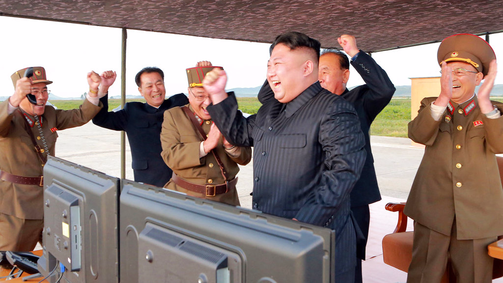 In this undated photo distributed on Saturday, Sept. 16 by the N. Korean government, N. Korean leader Kim Jong Un, center, celebrates what was said to be the test launch of an intermediate range Hwasong-12 missile at an undisclosed location in North Korea. Independent journalists were not given access to cover the event depicted in this image distributed by the N. Korean government. The content of this image is as provided and cannot be independently verified.