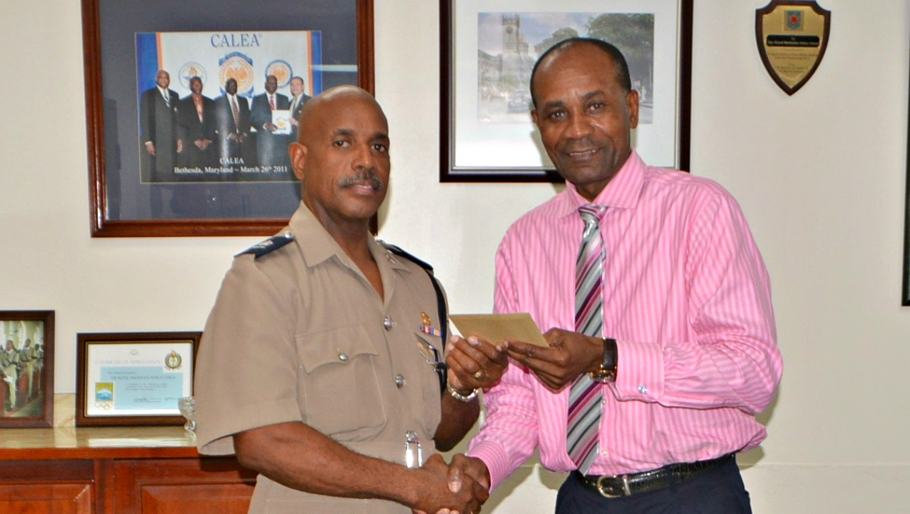 Superintendent Andrew Lynch receives his letter of appointment from Police Commissioner, Tyrone Griffith, at RBPF headquarters.