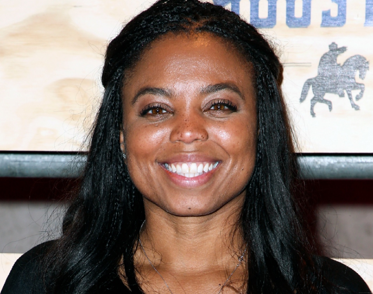 "This is a Feb. 3, 2017, file photo showing Jemele Hill attending ESPN: The Party 2017 in Houston, Texas. ESPN distanced itself from anchor Jemele Hill's tweets one day after she called President Donald Trump ""a white supremacist"" and ""a bigot."""