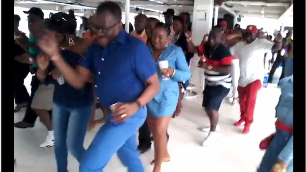 National Security Minister Edmund Dillon dances Electric Slide on party boat.