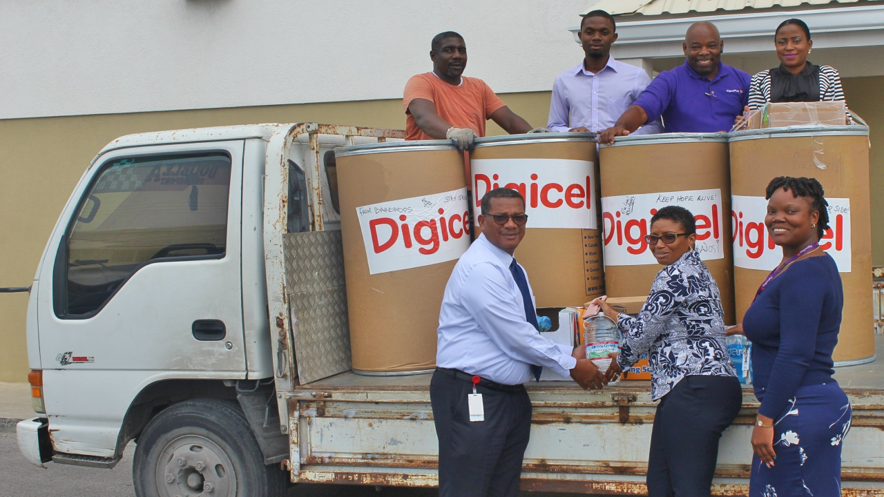 Digicel Barbados employees are joined by CEO Alex Tasker (left at the front) in preparing staff donations for transport to Irma-affected countries.