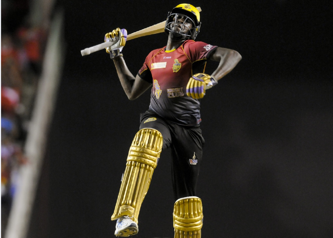 Kevon Cooper of Trinbago Knight Riders celebrates winning the Finals of the 2017 Hero Caribbean Premier League against Chris Gayle's St Kitts & Nevis Patriots at the Brian Lara Cricket Academy on September 09, 2017 in Tarouba, Trinidad.