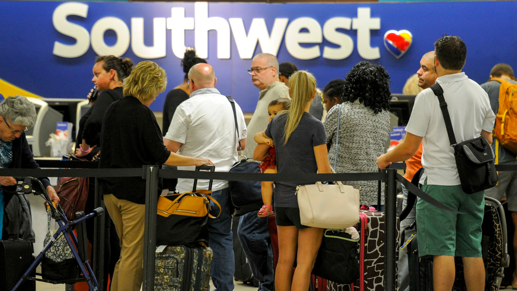 Passengers wait in line at the Southwest Airlines ticket counter Wednesday, Sept. 6, 2017 at Tampa International Airport. Many passengers were leaving Tampa on Wednesday ahead of Hurricane Irma which is threatening the Florida peninsula.