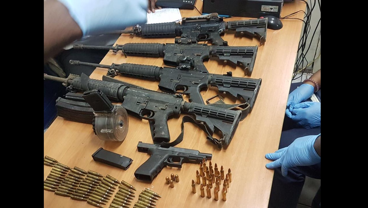 High-powered M16 rifles and ammunition recovered in Flankers, St James on Monday.