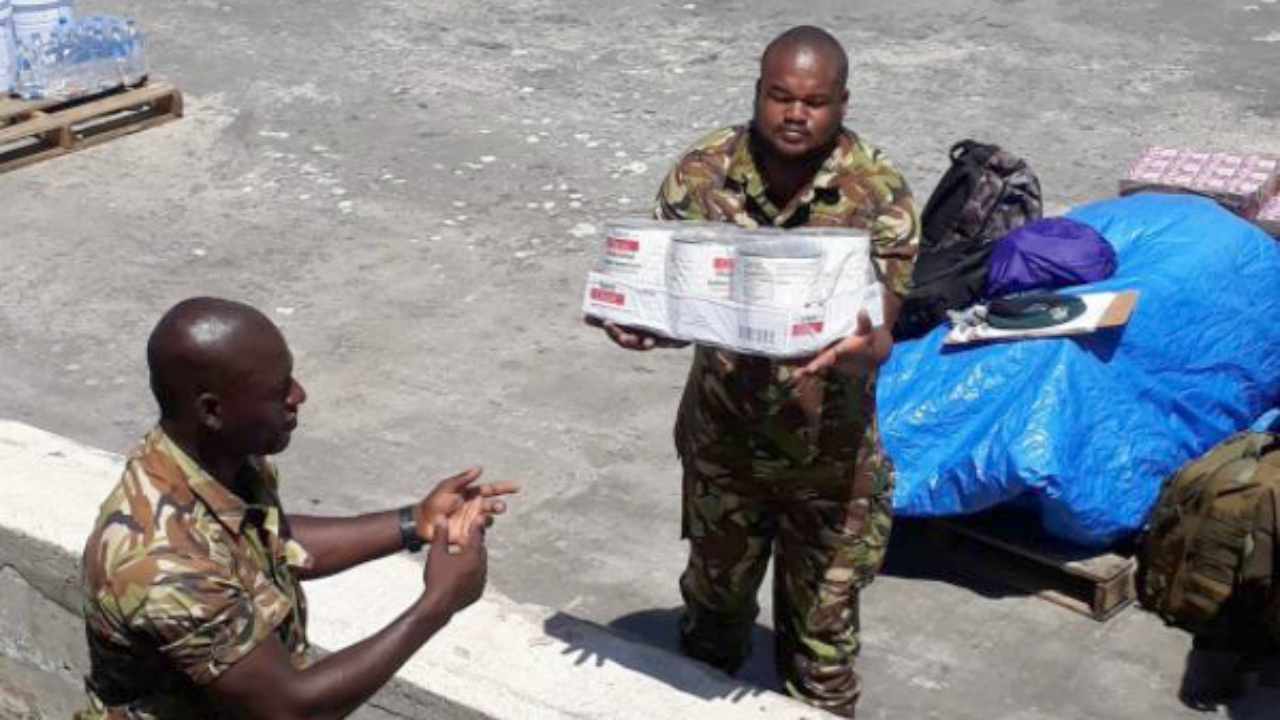 Members of the BDF unloading relief supplies in Dominica. (PHOTO: BGIS)