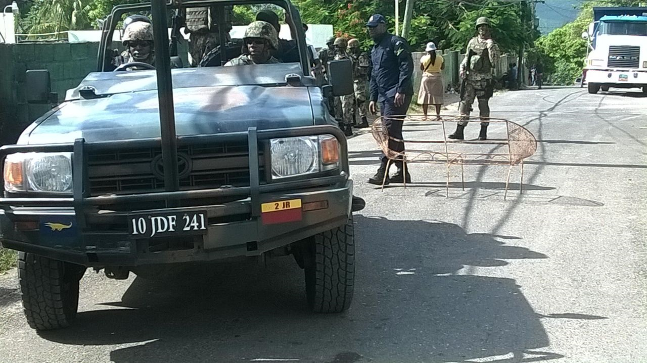 Soldiers and police in Mount Salem, St James on Friday.