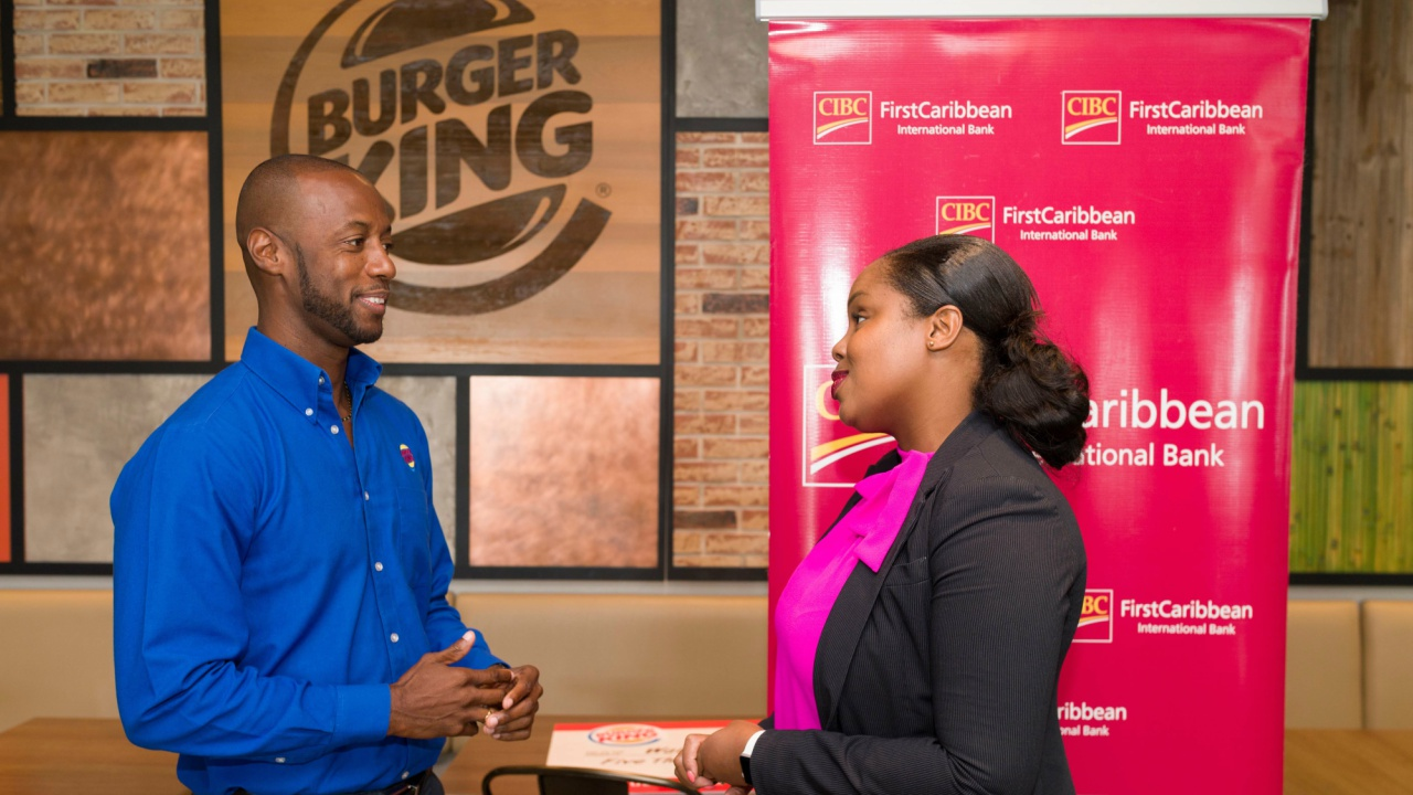 Burger King General Manager, Ryan Walters and FirstCaribbean Treasurer and Walk Manager, Krystle Maynard, discussing plans for this Sunday's Walk for the Cure.