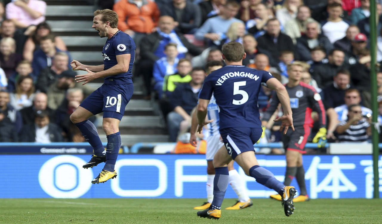 Tottenham's Harry Kane celebrates scoring his side's third goal of the game during the English Premier League match against Huddersfield at the John Smith's Stadium, Huddersfield, England. Saturday, Sept. 30, 2017