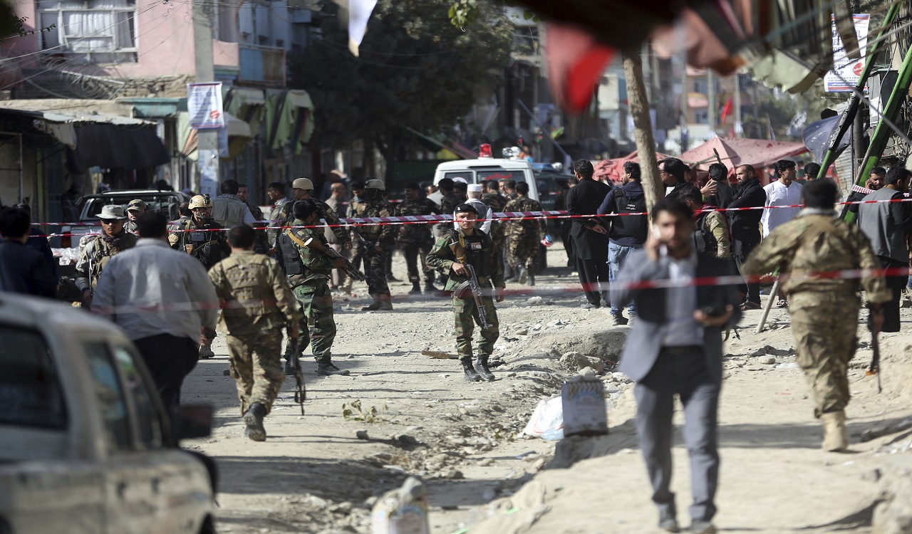 Security forces inspect the site of a suicide attack outside a Shiite mosque in Kabul, Afghanistan, Friday, Sept. 29, 2017.