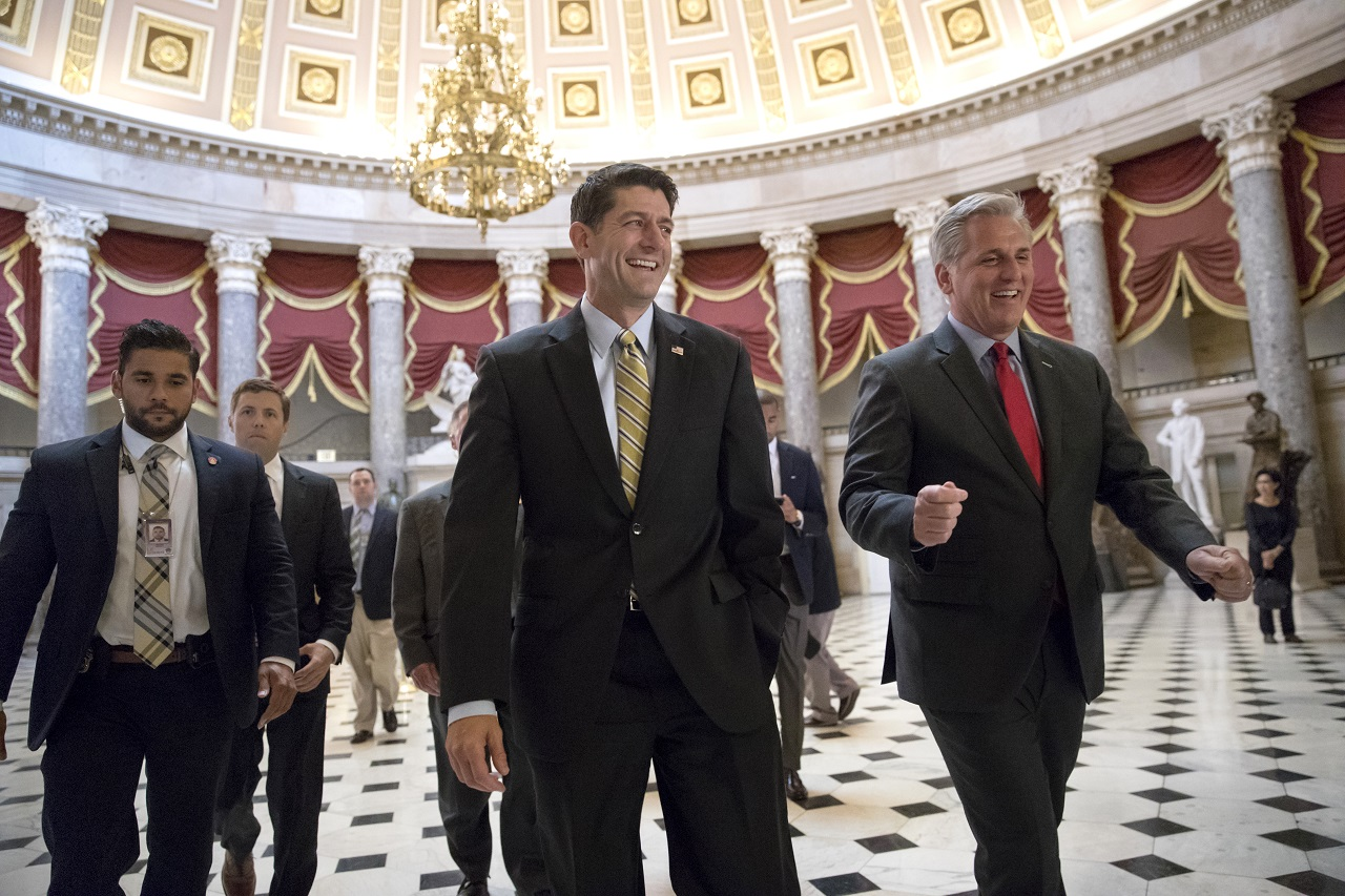 Speaker of the House Paul Ryan, R-Wis., center, and Majority Leader Kevin McCarthy, R-Calif., right, walk to the chamber where the House voted overwhelmingly to send a $15.3 billion disaster aid package to President Donald Trump, overcoming conservative objections to linking the emergency legislation to a temporary increase in America's borrowing authority, Friday, Sept 8, 2017 in Washington.