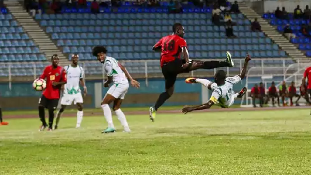 File Photo: Shirvone Malik St. Prix, centre, looks on as his W Connection teammate Hughtun Hector sends an acrobatic attempt towards goal in a Pro League clash against San Juan Jabloteh. St. Prix scored a hat-trick in Connection's 12-0 hammering of Tamana United in the FA Trophy 2017 Round-of-64.