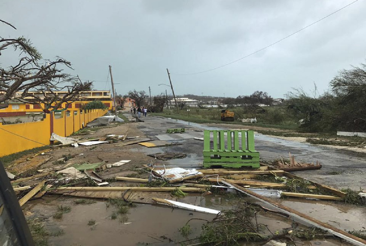 This Wednesday, Sept. 6, 2017 photo shows storm damage in the aftermath of Hurricane Irma in the British overseas territory of Anguilla. Irma scraped Cuba's northern coast Friday on a course toward Florida, leaving in its wake a ravaged string of Caribbean resort islands strewn with splintered lumber, corrugated metal and broken concrete.