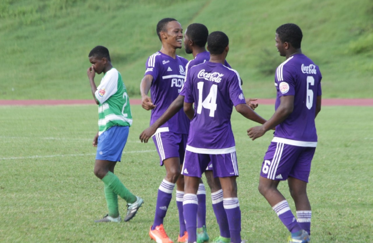 Kingston College players celebrating one of their 12 goals against Norman Manley in the ISSA/FLOW Manning Cup competition at the Stadium East field on Friday.
