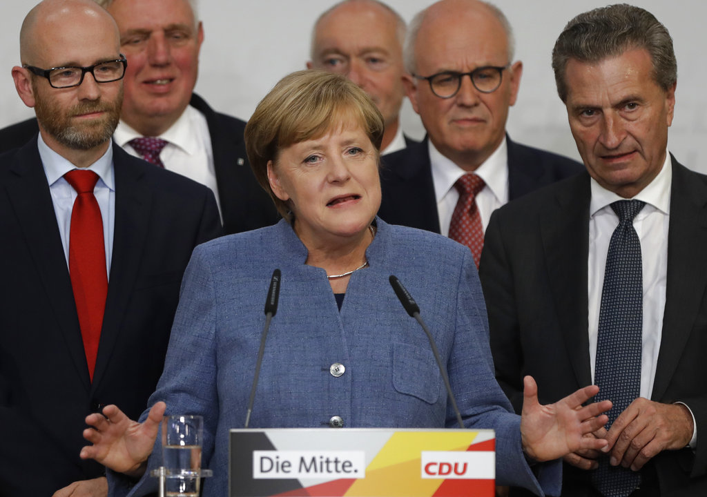 German Chancellor Angela Merkel gives a statement on the parliament election at the headquarters of the Christian Democratic Union CDU in Berlin, Germany, Sunday, Sept. 24, 2017. (AP Photo/Michael Sohn)