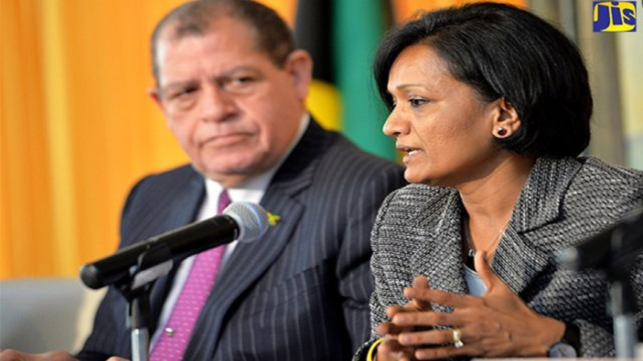 IMF team leadet Dr Uma Ramakrishnan, addresses journalists during an IMF quarterly review, while Finance Minister Audley Shaw looks on. (PHOTO: JIS File)