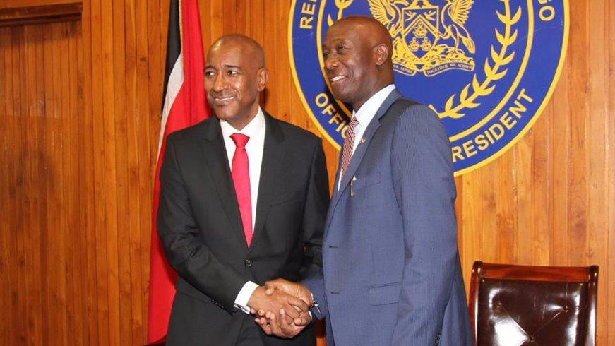 Robert Le Hunte (left) shakes hands with Prime Minister Dr Keith Rowley at his swearing in ceremony at the Office of the President August 25, 2017. Photo via The Office of the Prime Minister.