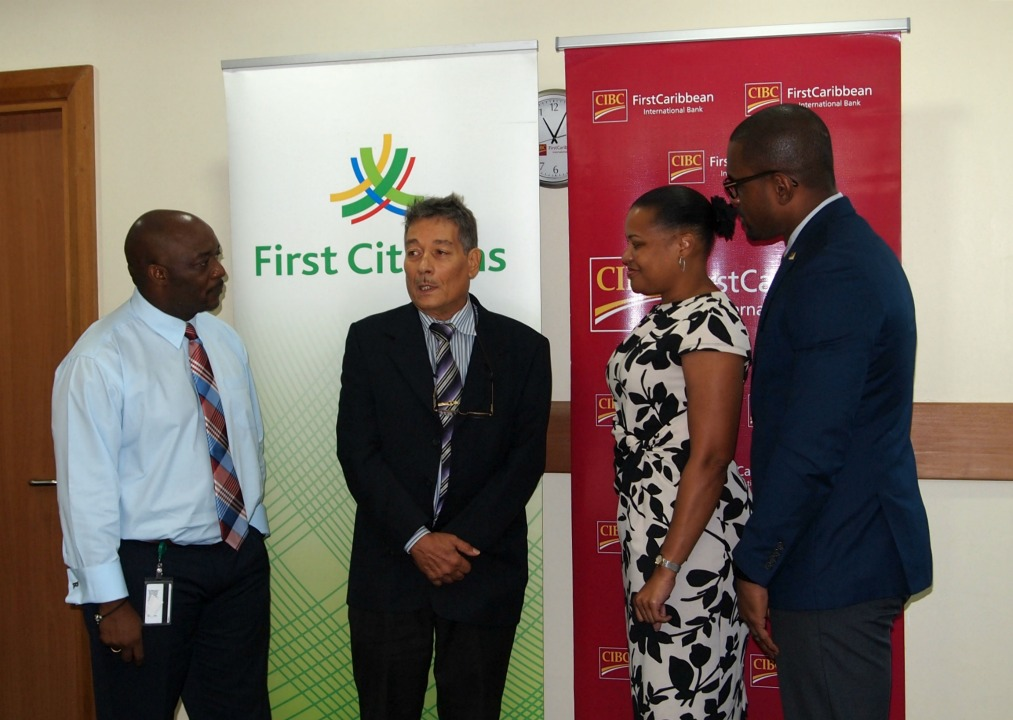 (l-r) Manager of First Citizens Broad Street, Ryan Hunte, Director General of the Barbados Red Cross, Edmond Bradshaw; Managing Director of CIBC First Caribbean, Donna Wellington and Branch Manager of CIBC First Caribbean Warrens Business Center, Malcolm Martindale.