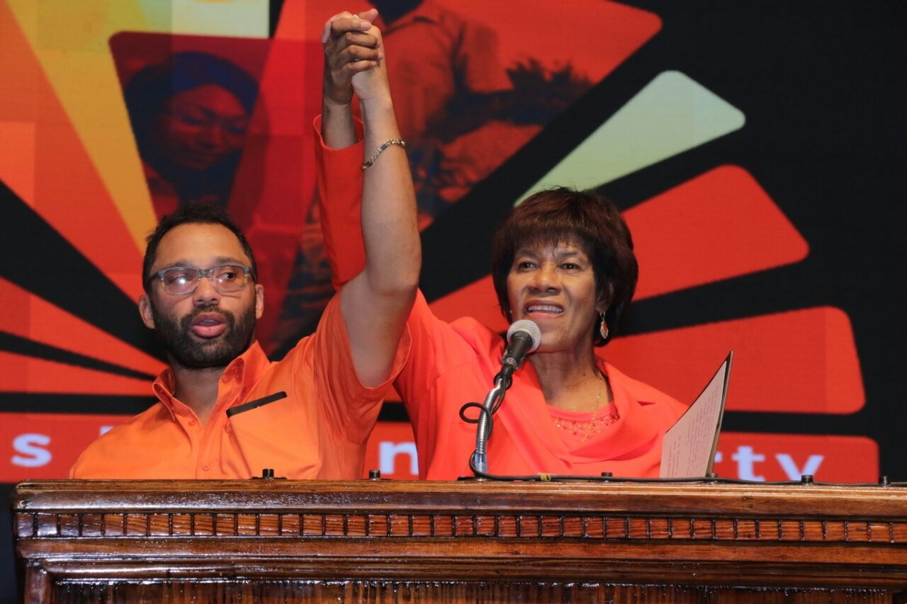 Dr Shane Alexis, the party's newly-minted candidate for the South East St Mary constituency and former PNP Leader Portia Simpson Miller.