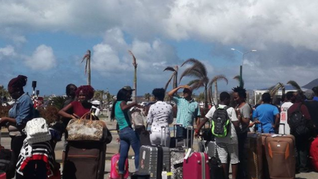 Caricom nationals wait in line to enter the Princess Juliana airport for their flight to T&T