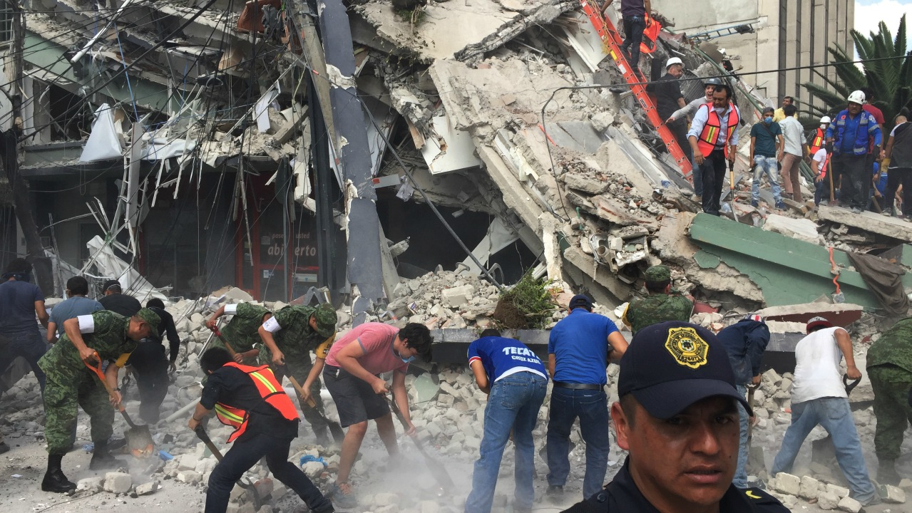 Rescue workers and volunteers search for survivors in Mexico City,
