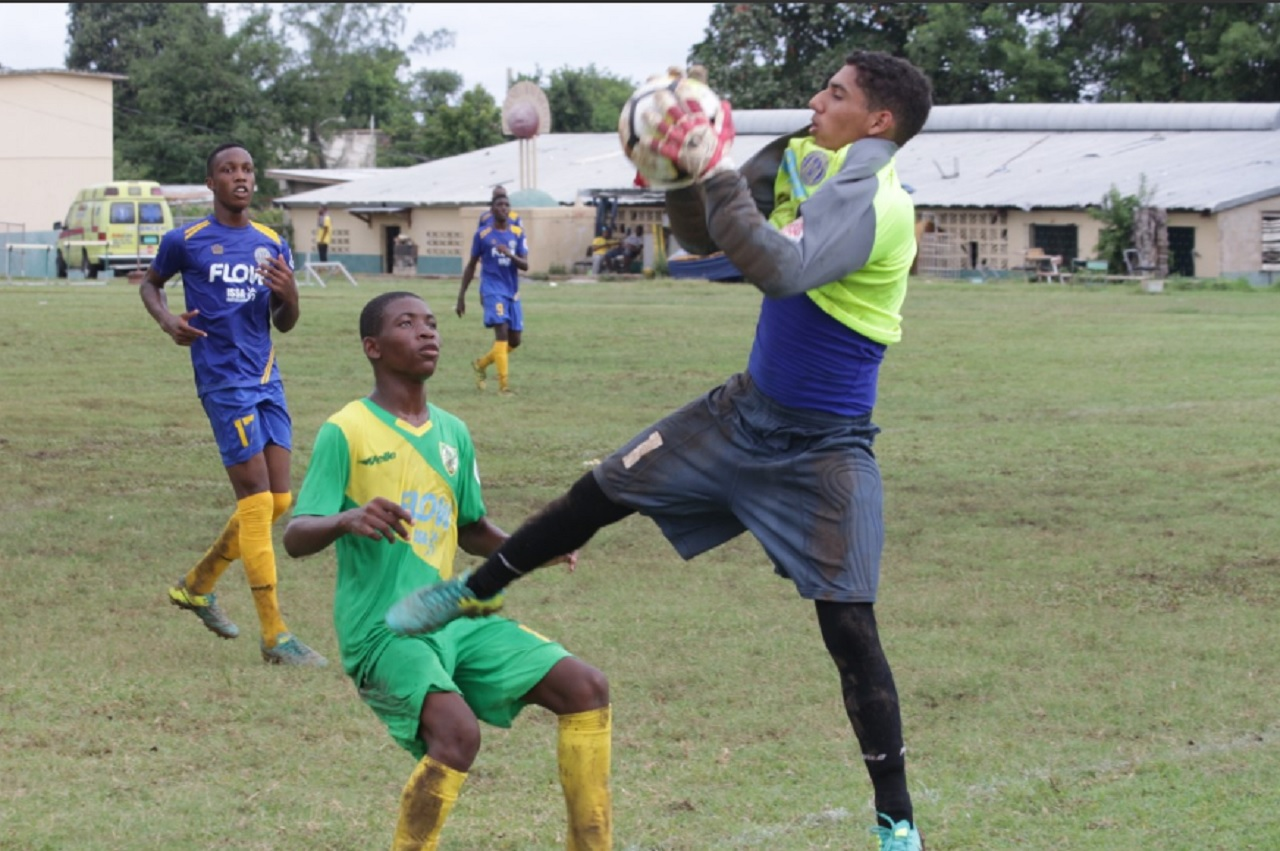 Goalkeeper Hossain Martinez Jr. of Ardenne makes a save ahead of Excelsior's Rohan Beadle during their ISSA/FLOW Manning Cup fixture at Excelsior High School on Saturday's opening day of competition. Excelsior won 3-0.