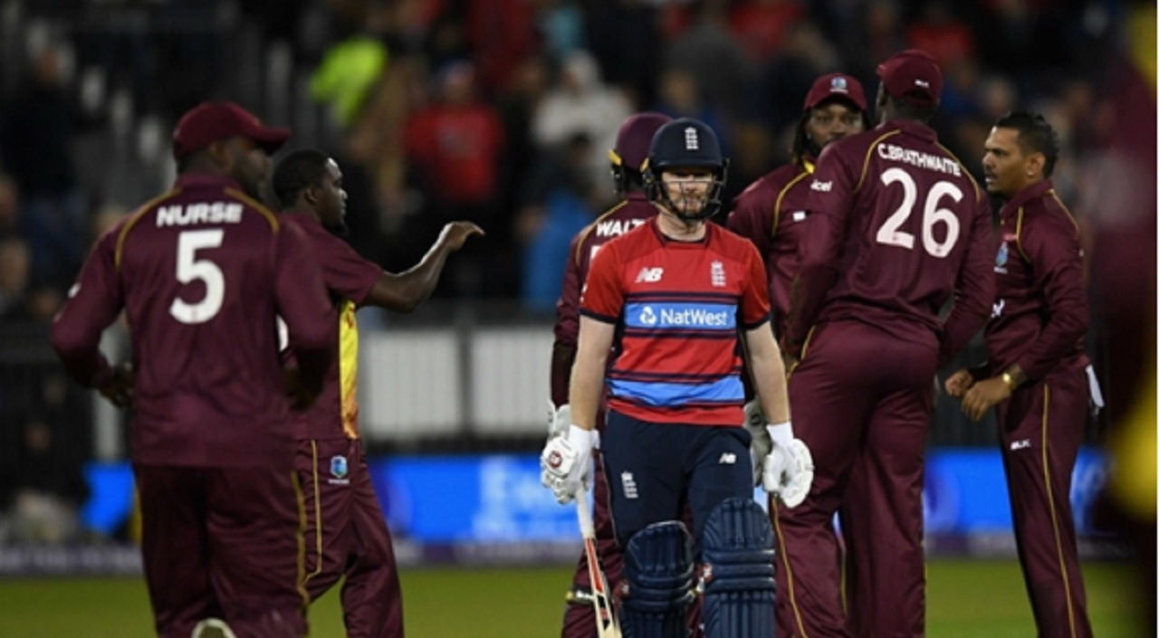 West Indies players celebrate the dismissal of England captain Eoin Morgan.