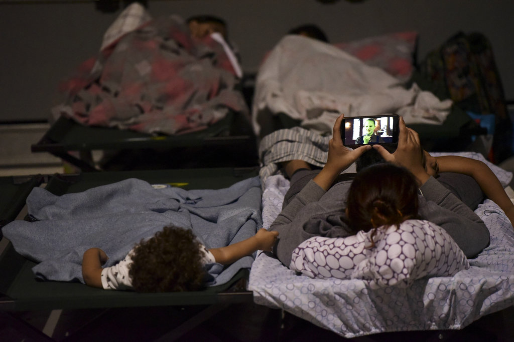 A woman and a child rest on cots while waiting at Humacao Arena refugee center for the imminent impact of Maria, a Category 5 hurricane that threatens to hit the eastern region of the island with sustained winds of 175 miles per hour, in Humacao, Puerto Rico, Tuesday, September 19, 2017. About 137 citizens arrived at the refuge from different parts of the eastern region of the Island. (AP Photo/Carlos Giusti)